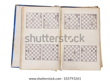 An old retro vintage  classic mass production learning book with the standard images of chess positions isolated. - stock photo