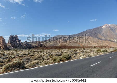 An old road crosses a wide arid and very volcanic zone