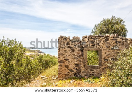 An old ruin of a house on the Greek island of Crete. - stock photo
