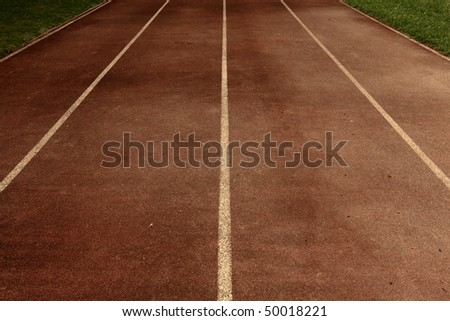 an old running track - stock photo