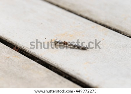 An Old Rust Nail on Wooden Floor