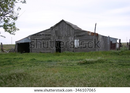 An old rustic barn in a field