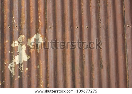 An Old Rusty Damaged Piece Of Metal Roofing