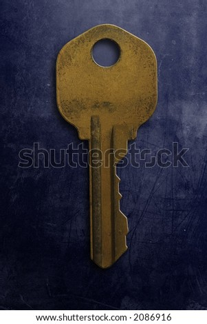 An old rusty key on a grunge textured background