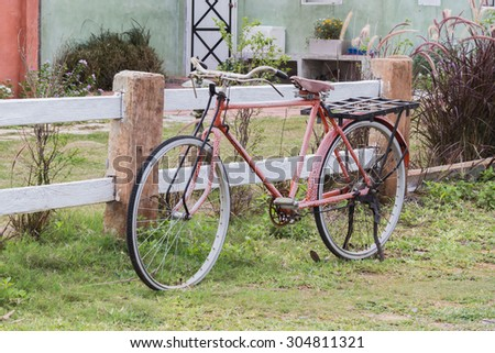 An old rusty red bicycle