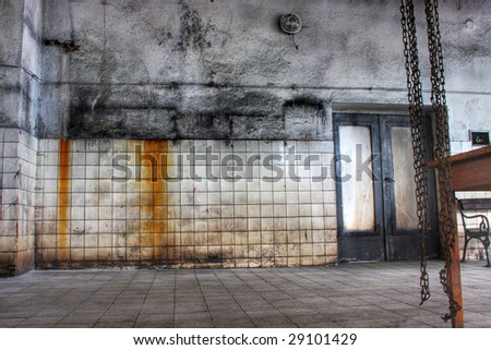 An old rusty weathered door - stock photo