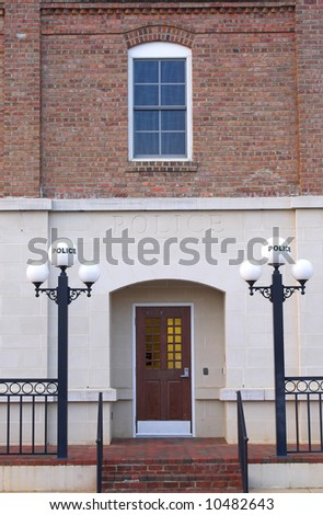 An old 1940's style historic police station. - stock photo