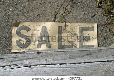 An old sale sign from a flea market - stock photo