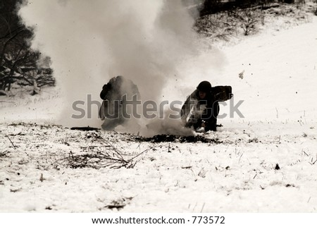 An old, sepia, and grainy WWII photo of American Soldier running for cover from mortar explosions - stock photo