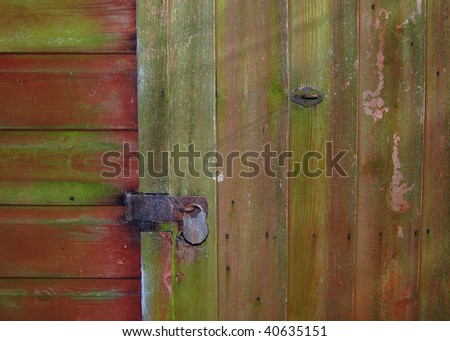 An old shed door with a padlock