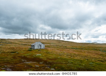 An old shed in rural norwegian landscape - stock photo