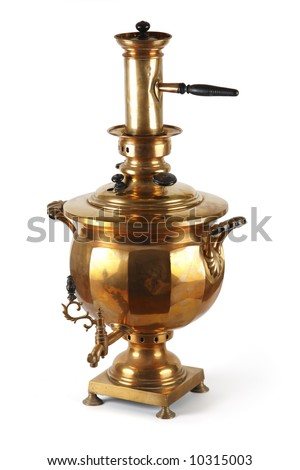 An old shiny samovar. The traditional Russian kitchen utensil.