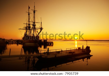 An old ship and sunset - stock photo