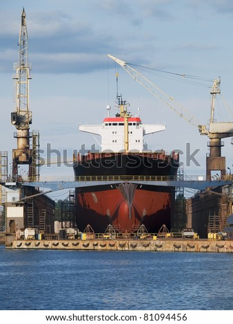 An old ship during hull repair - stock photo