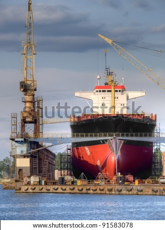 An old ship in a repair shipyard - stock photo
