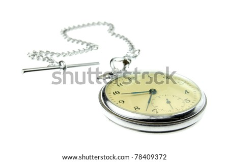 an old silver pocket watch isolated on a white background