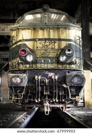 An old spooky train, left at an abandoned train workshop. - stock photo