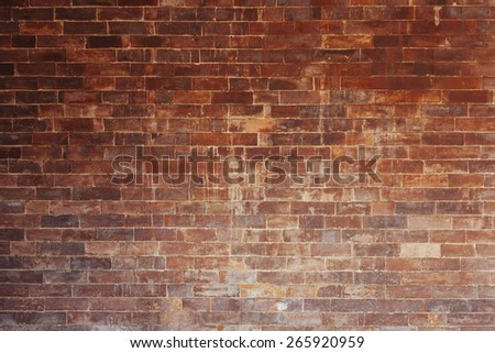 An old stained brick wall. - stock photo