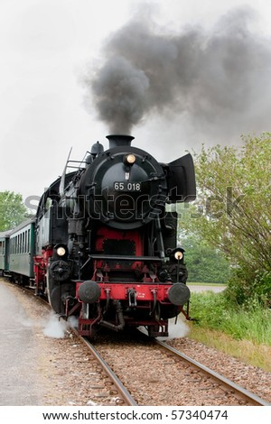 an old steam train on the track - stock photo