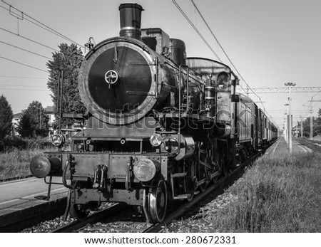 an old steam train stopped at the station - stock photo