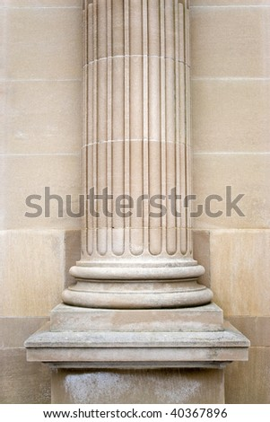 An old stone column on the exterior of a building.