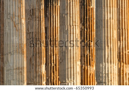 An old stone column texture on the exterior of a building. - stock photo