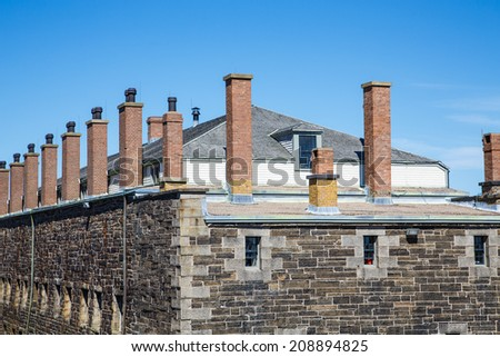 An old stone fort in Halifax, Nova Scotia under blue skies - stock photo