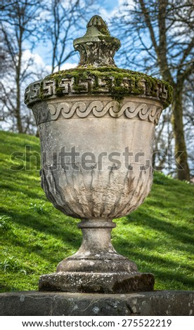 An old stone urn in Buxton at the park slopes antrance. - stock photo