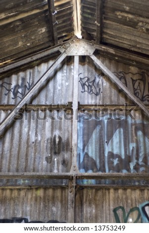 An old structure that is covered with graffiti. - stock photo