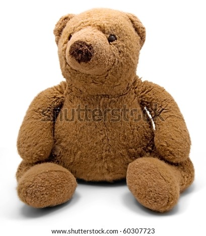An old teddy bear on a white background - stock photo