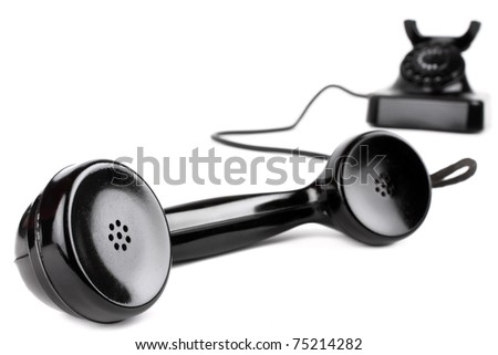 an old telephon with rotary dial - stock photo
