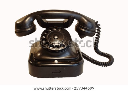 an old telephon with rotary dial / Old rotary phone on white background - stock photo