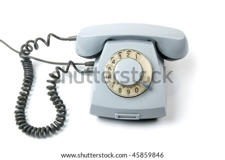 An old telephone with a rotary dial. White background. - stock photo