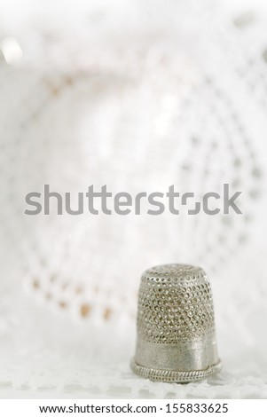 an old thimble and lace backdrop, shallow dof