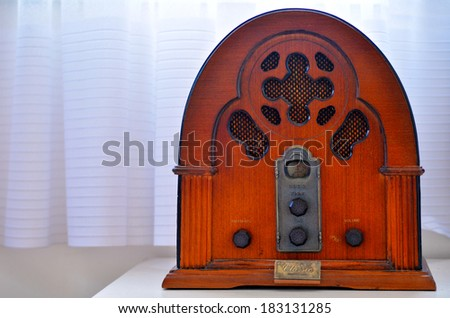 An old time classic radio on wooden shelf. - stock photo