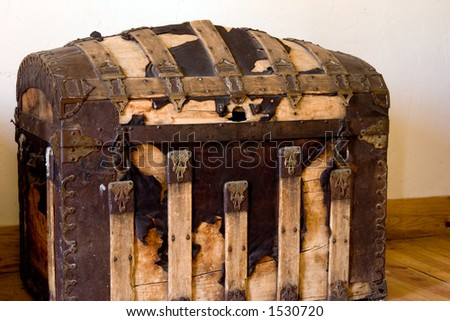An old time travelers trunk used mainly on steamers and railroads. - stock photo