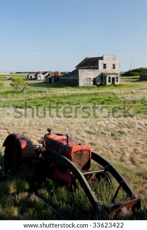 An old tractor in the Canadian Prairie ghost town of Bents. - stock photo