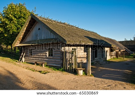 an old traditional belorussian house in the countryside - stock photo