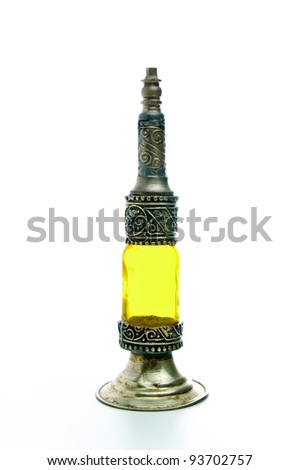 An old traditional handmade oriental perfume dispenser on a white background