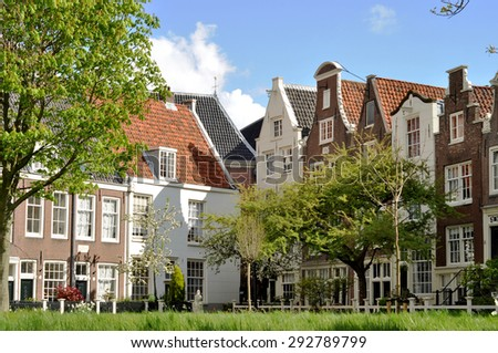 An old traditional oblique houses at the Begijnhof in Amsterdam