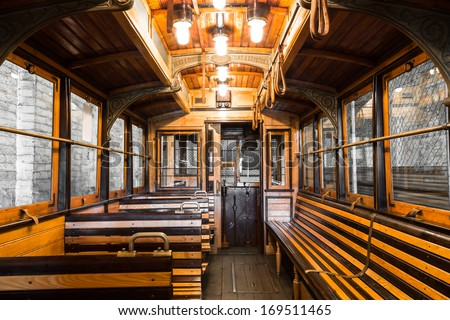 an old tram interior, wooden seats in the garage - stock photo