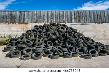 An old tyre pile in a yard.