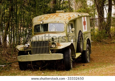 An old US Army medic truck that has been shot up