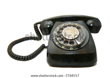An old vintage black telephone in white background.