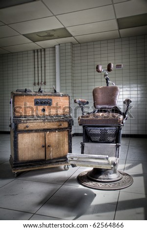 An old vintage, dentist chair expressing the anxious for a dentist visit - stock photo