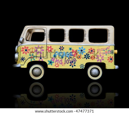An old vintage hippie peace and love van over a black background - stock photo