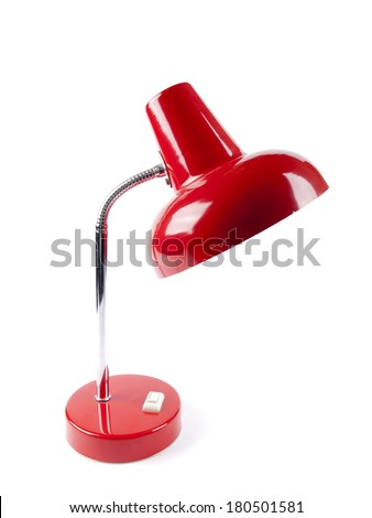 An old vintage red desk lamp with a light bulb - stock photo