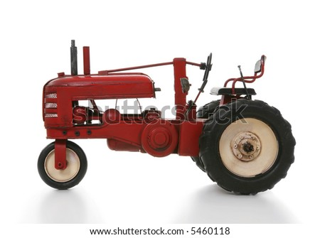 An old vintage tractor isolated over white - stock photo