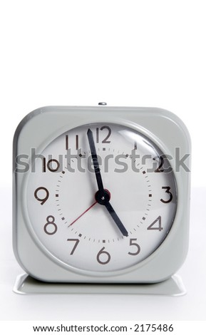 An old vintage wind operated alarm clock - stock photo