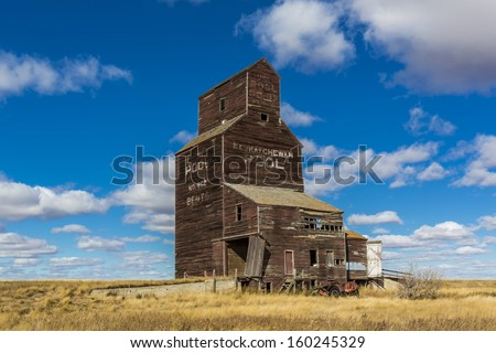 An old vintage wooden grain elevator in the ghost town of Bents, Saskatchewan - stock photo